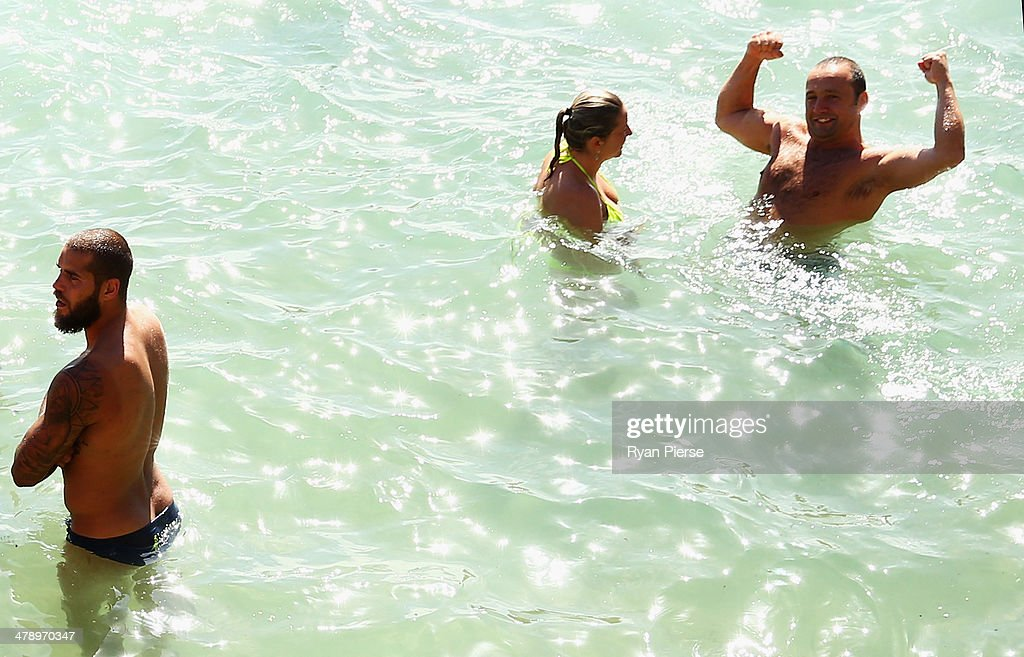 Lance Franklin of the Swans swims during a Sydney Swans AFL recovery session at Coogee Beach on March 16, 2014 in Sydney, Australia.