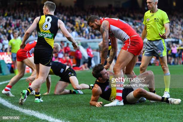 Lance Franklin of the Swans tussles with Alex Rance of the Tigers during the 2017 AFL round 13 match between the Richmond Tigers and the Sydney Swans...