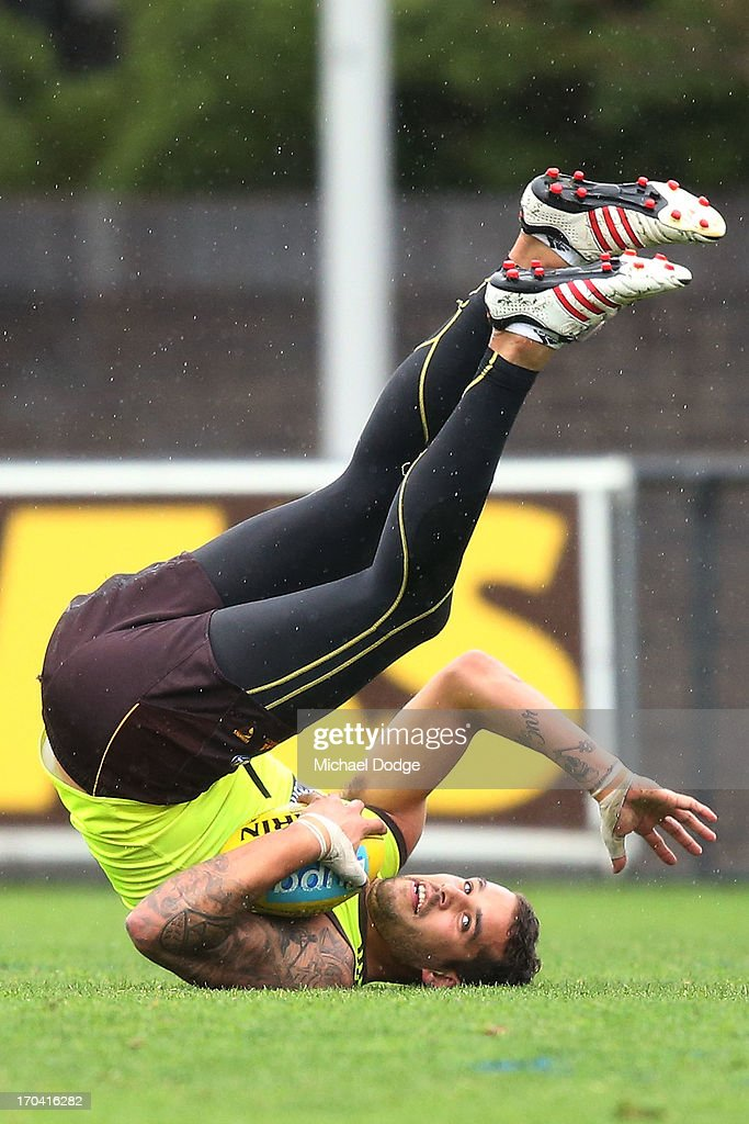 <a gi-track='captionPersonalityLinkClicked' href=/galleries/search?phrase=Lance+Franklin&family=editorial&specificpeople=561332 ng-click='$event.stopPropagation()'>Lance Franklin</a> tumbles after a mark during a Hawthorn Hawks AFL training session at Waverley Park on June 13, 2013 in Melbourne, Australia.