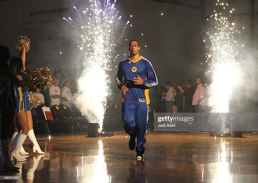 Lance Goulbourne #24 of the Santa Cruz Warriors runs through fireworks during player introductions prior to their game against the Bakersfield Jam on December 23, 2012 at Kaiser Permanente Arena in Santa Cruz, California.