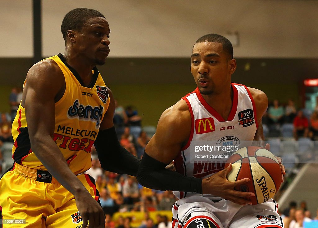 Lance Hurdle of the Hawks is pressured by Jonny Flynn of the Tigers during the round eight NBL match between the Melbourne Tigers and the Wollongong Hawks at State Netball Hockey Centre on November 25, 2012 in Melbourne, Australia.