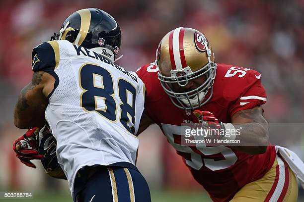 Lance Kendricks of the St Louis Rams is tackled by Ahmad Brooks of the San Francisco 49ers during their NFL game at Levi's Stadium on January 3 2016...