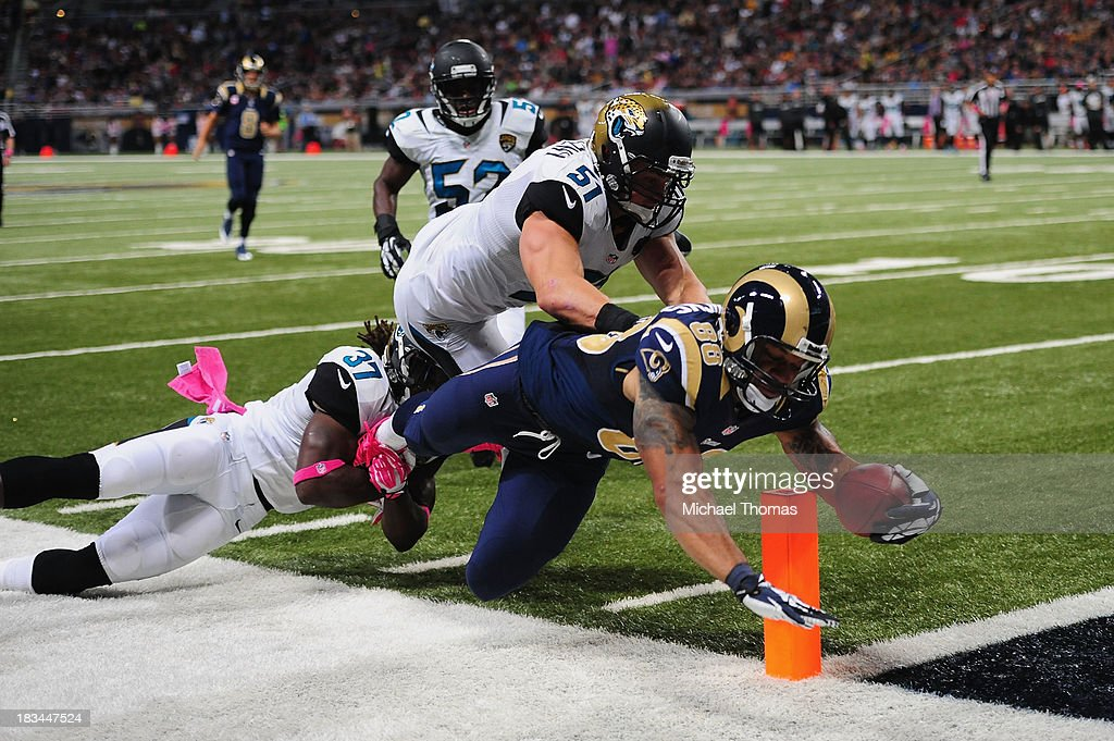 <a gi-track='captionPersonalityLinkClicked' href=/galleries/search?phrase=Lance+Kendricks&family=editorial&specificpeople=5512848 ng-click='$event.stopPropagation()'>Lance Kendricks</a> #88 of the St. Louis Rams scores a touchdown against the Jacksonville Jaguars at the Edward Jones Dome on October 6, 2013 in St. Louis, Missouri.
