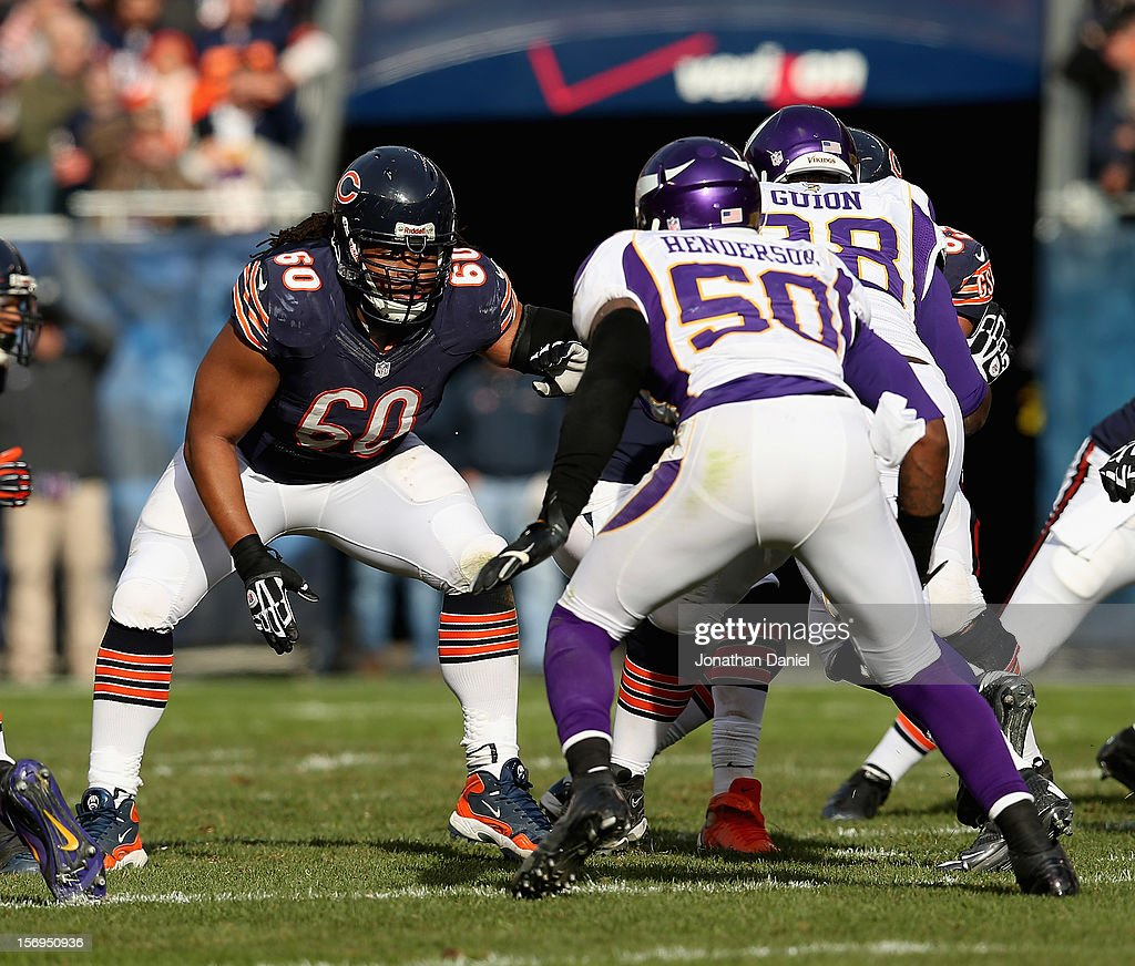 Lance Louis #60 of the Chicago Bears moves to block Erin Henderson #50 of the Minnesota Vikings at Soldier Field on November 25, 2012 in Chicago, Illinois. The Bears defeated the Vikings 28-10.