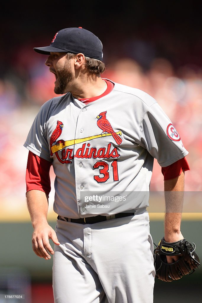 <a gi-track='captionPersonalityLinkClicked' href=/galleries/search?phrase=Lance+Lynn&family=editorial&specificpeople=6800756 ng-click='$event.stopPropagation()'>Lance Lynn</a> #31 of the St. Louis Cardinals celebrates after striking out a Cincinnati Reds batter to end the eighth inning at Great American Ball Park on August 4, 2013 in Cincinnati, Ohio. St. Louis defeated Cincinnati 15-2.
