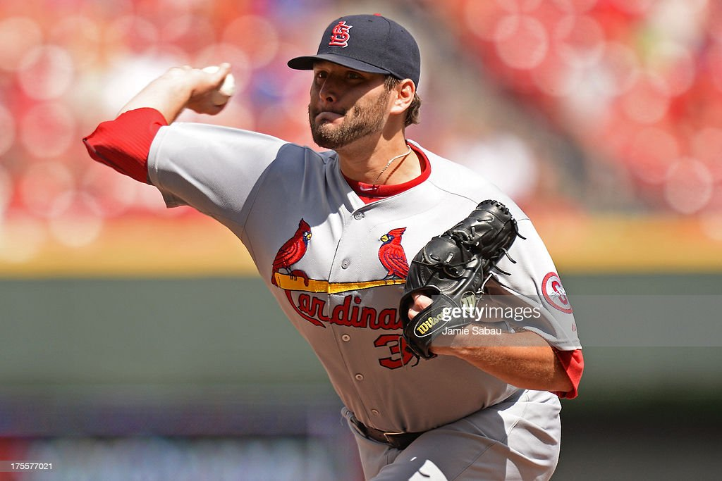 <a gi-track='captionPersonalityLinkClicked' href=/galleries/search?phrase=Lance+Lynn&family=editorial&specificpeople=6800756 ng-click='$event.stopPropagation()'>Lance Lynn</a> #31 of the St. Louis Cardinals delivers his last pitch, a strike, in the eighth inning against the Cincinnati Reds at Great American Ball Park on August 4, 2013 in Cincinnati, Ohio. Lynn pitched eight complete innings as St. Louis defeated Cincinnati 15-2.
