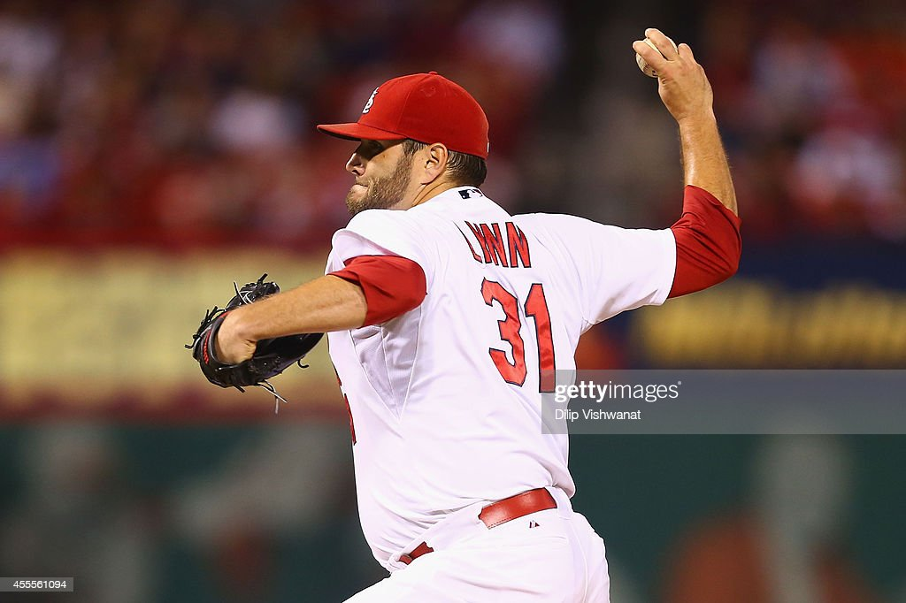 Lance Lynn of the St Louis Cardinals pitches against the Milwaukee Brewers in the first inning at Busch Stadium on September 16 2014 in St Louis...