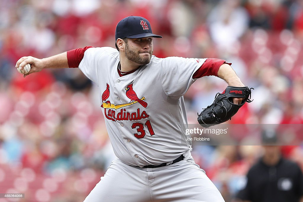 Lance Lynn of the St Louis Cardinals pitches in the third inning of the game against the Cincinnati Reds at Great American Ball Park on September 11...