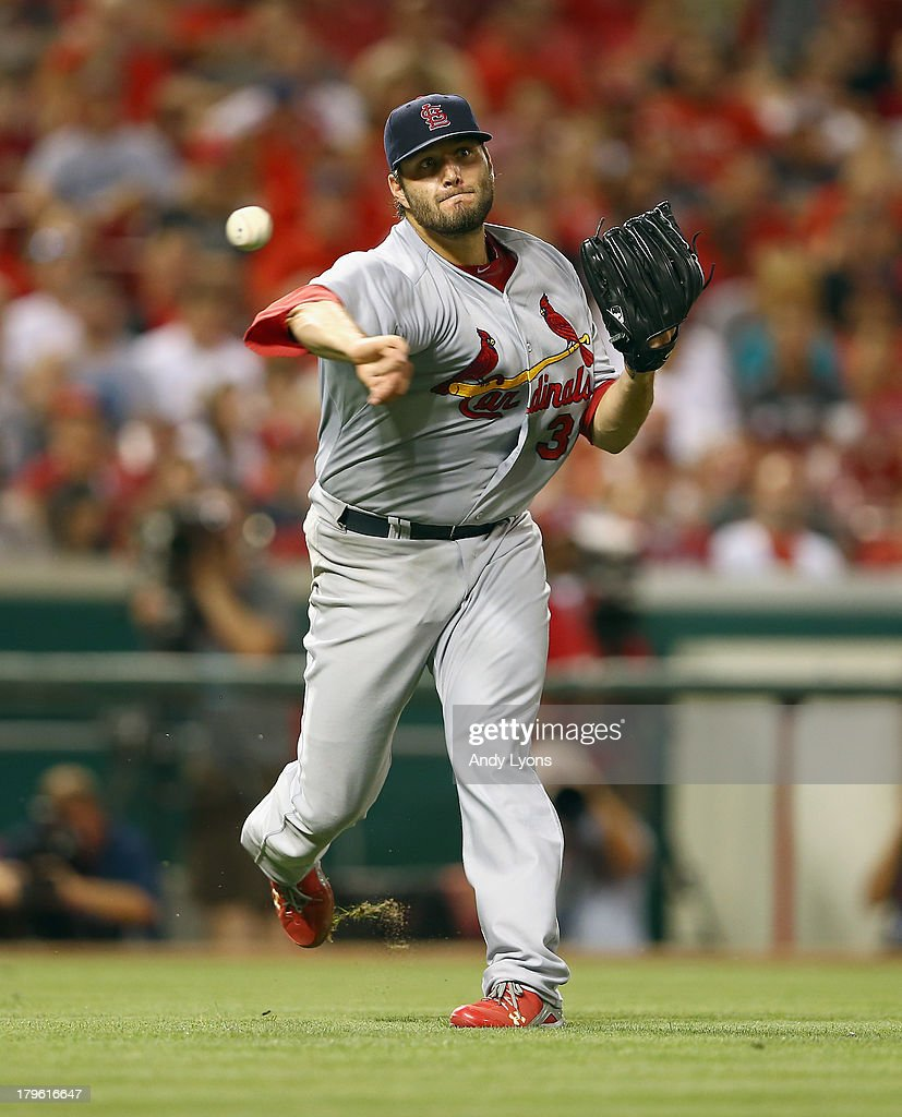 Lance Lynn #31 of the St. Louis Cardinals throws to first base during the game against the Cincinnati Reds at Great American Ball Park on September 5, 2013 in Cincinnati, Ohio.