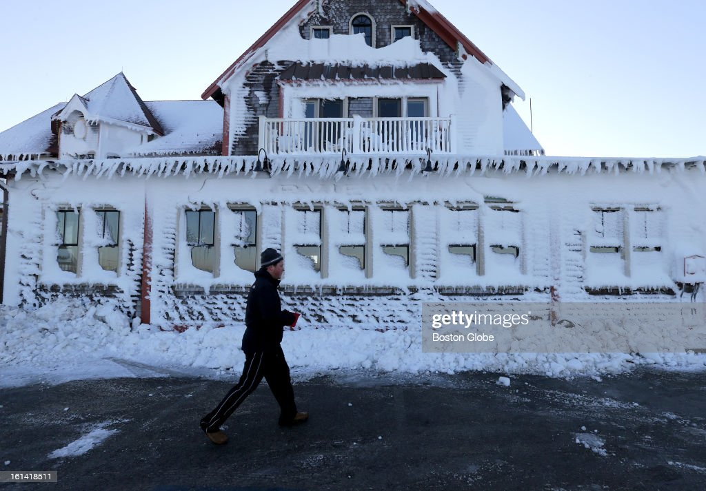 Lance Marquardt, of Duxbury, outside the frozen front facade of the Fairview Restaurant and Inn on Ocean Street in Marshfield on Sunday, Feb. 10, 2013, after a blizzard hit New England.