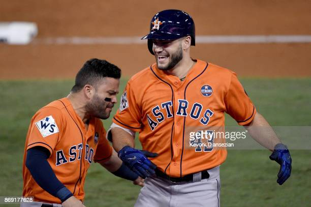 Lance McCullers Jr #43 of the Houston Astros celebrates with Jose Altuve after grounding out to score Brian McCann during the second inning against...
