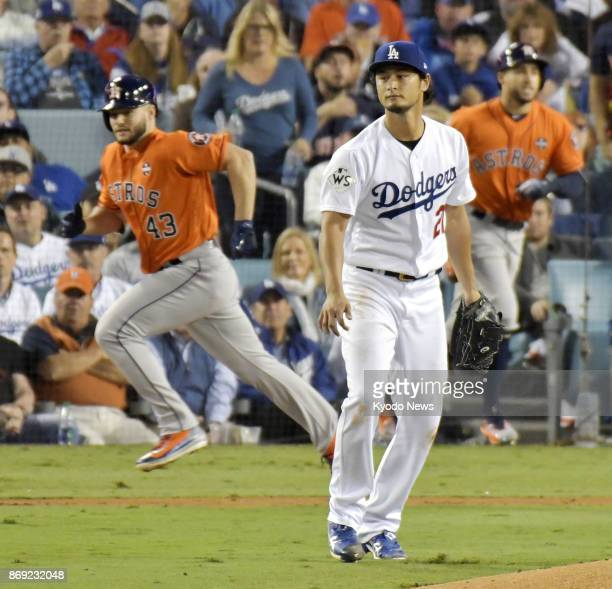 Lance McCullers Jr of the Houston Astros has a runscoring groundout in the second inning off Yu Darvish of the Los Angeles Dodgers in Game 7 of the...