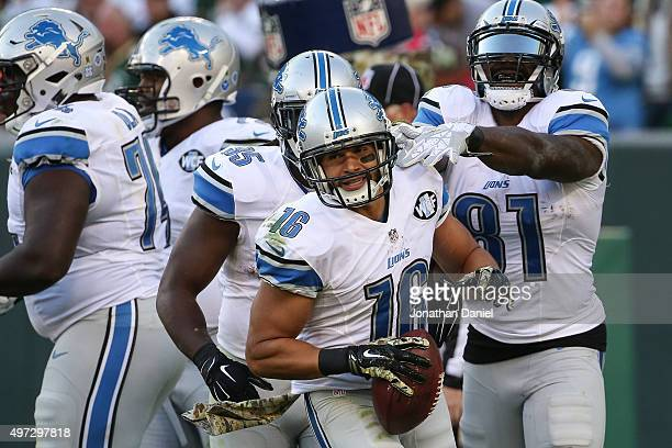 Lance Moore of the Detroit Lions celebrates after scoring the game winning touchdown against the Green Bay Packers in the fourth quarter at Lambeau...