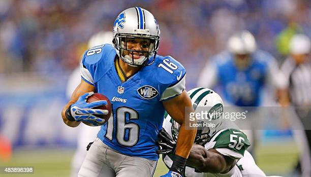 Lance Moore of the Detroit Lions runs for a first down as Demario Davis of the New York Jets attempts to make the stop during the first quarter of...