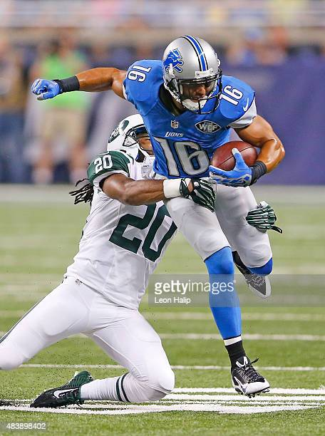 Lance Moore of the Detroit Lions runs for a short gain as Marcus Williams of the New York Jets makes the stop during the first quarter of the...