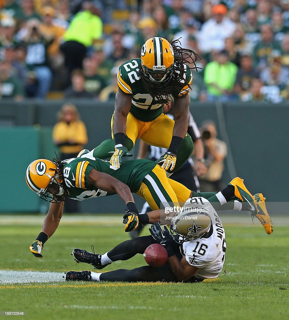 Lance Moore #16 of the New Orleans Saints can't make a catch as Tramon Williams #38 and Jerron McMillian #22 of the Green Bay Packers defend at Lambeau Field on September 30, 2012 in Green Bay, Wisconsin. The Packers defeated the Saints 28-27.