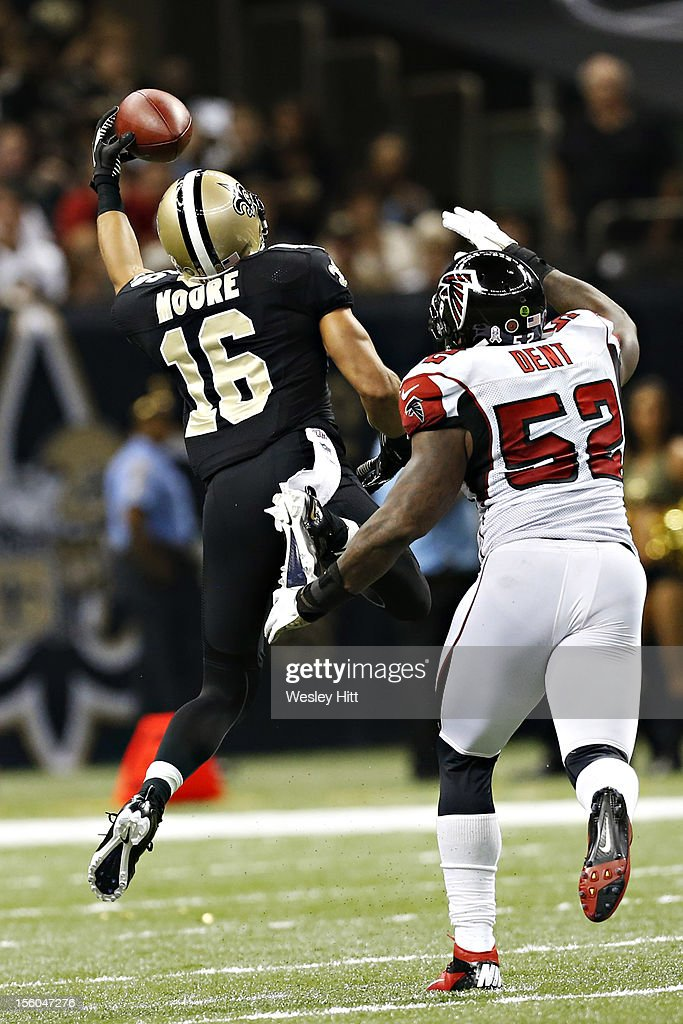 <a gi-track='captionPersonalityLinkClicked' href=/galleries/search?phrase=Lance+Moore&family=editorial&specificpeople=748984 ng-click='$event.stopPropagation()'>Lance Moore</a> #16 of the New Orleans Saints catches a pass one-handed over Akeem Dent #52 of the Atlanta Falcons at Mercedes-Benz Superdome on November 11, 2012 in New Orleans, Louisiana. The Saints defeated the Falcons 31-27.