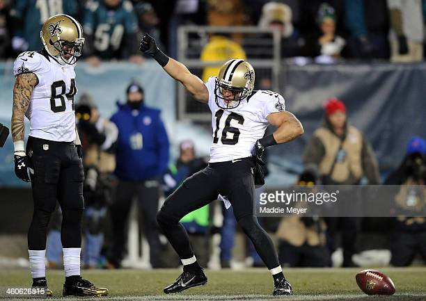 Lance Moore of the New Orleans Saints celebrates with teammate Kenny Stills after scoring a 24 yard touchdown thrown by Drew Brees in the third...