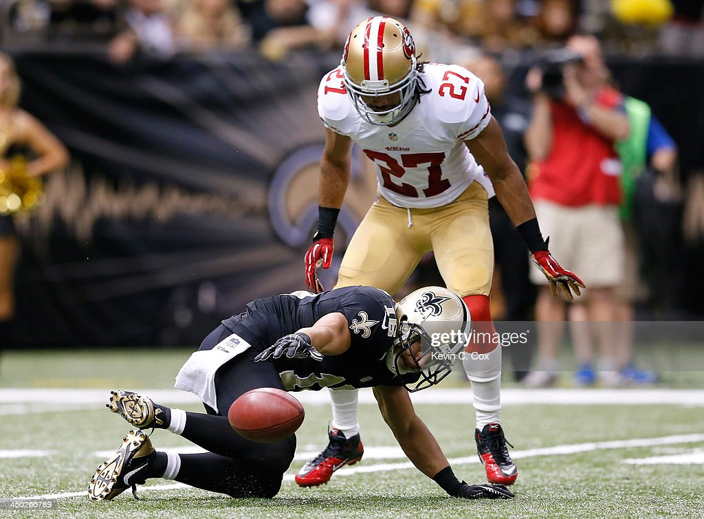 <a gi-track='captionPersonalityLinkClicked' href=/galleries/search?phrase=Lance+Moore&family=editorial&specificpeople=748984 ng-click='$event.stopPropagation()'>Lance Moore</a> #16 of the New Orleans Saints fumbles a punt against <a gi-track='captionPersonalityLinkClicked' href=/galleries/search?phrase=C.J.+Spillman&family=editorial&specificpeople=4650610 ng-click='$event.stopPropagation()'>C.J. Spillman</a> #27 of the San Francisco 49ers at Mercedes-Benz Superdome on November 17, 2013 in New Orleans, Louisiana.