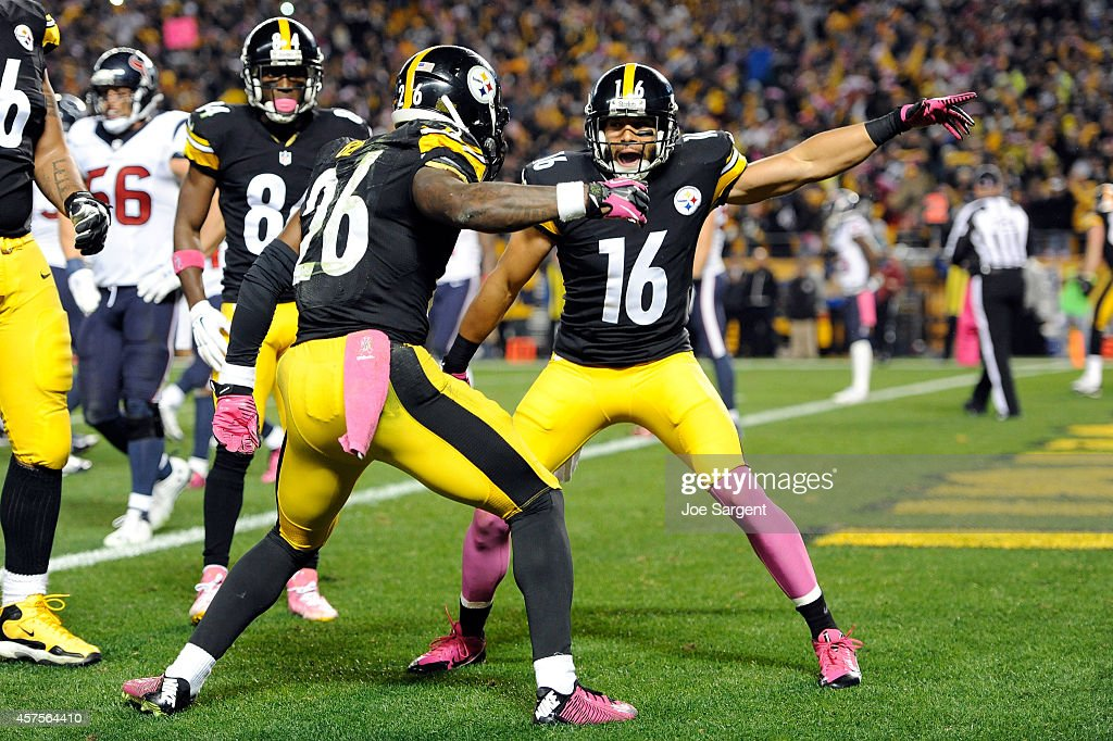 Lance Moore #16 of the Pittsburgh Steelers celebrates with Le'Veon Bell #26 after catching a touchdown passed by Antonio Brown #84 in the second quarter against the Houston Texans during their game at Heinz Field on October 20, 2014 in Pittsburgh, Pennsylvania.