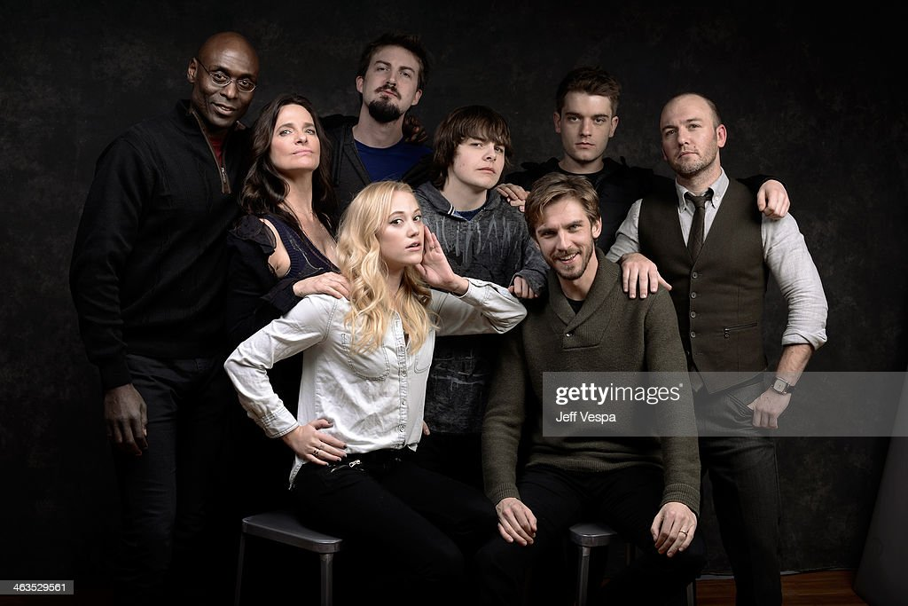 Lance Reddick, Sheila Kelley, Maika Monroe, Adam Wingard, Brendan Meyer, Dan Stevens, Chase Williamson, and Simon Barrett pose for a portrait during the 2014 Sundance Film Festival at the WireImage Portrait Studio at the Village At The Lift Presented By McDonald's McCafe on January 18, 2014 in Park City, Utah.