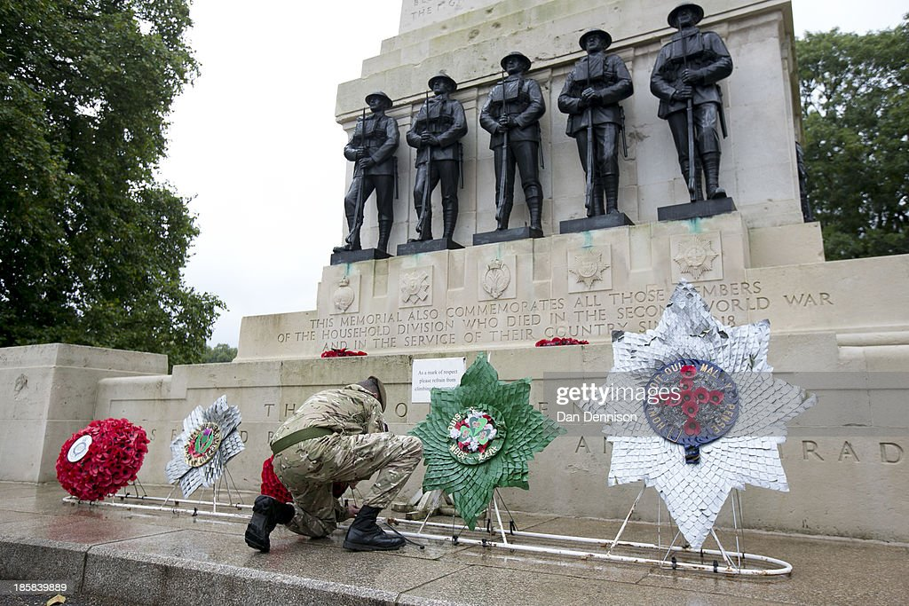 Lance Sargeant Davis prepares Battalion wreaths for the (from left) Grenadier, Scots, Welsh, Irish and Coldstream Guards at the Guards Memorial ahead of a recruitment day on October 25, 2013 in London, England. The recruitment day sees TA units from the Greater London area getting together for a one-off, interactive experience that will demonstrate their wide-ranging skills and capabilities.