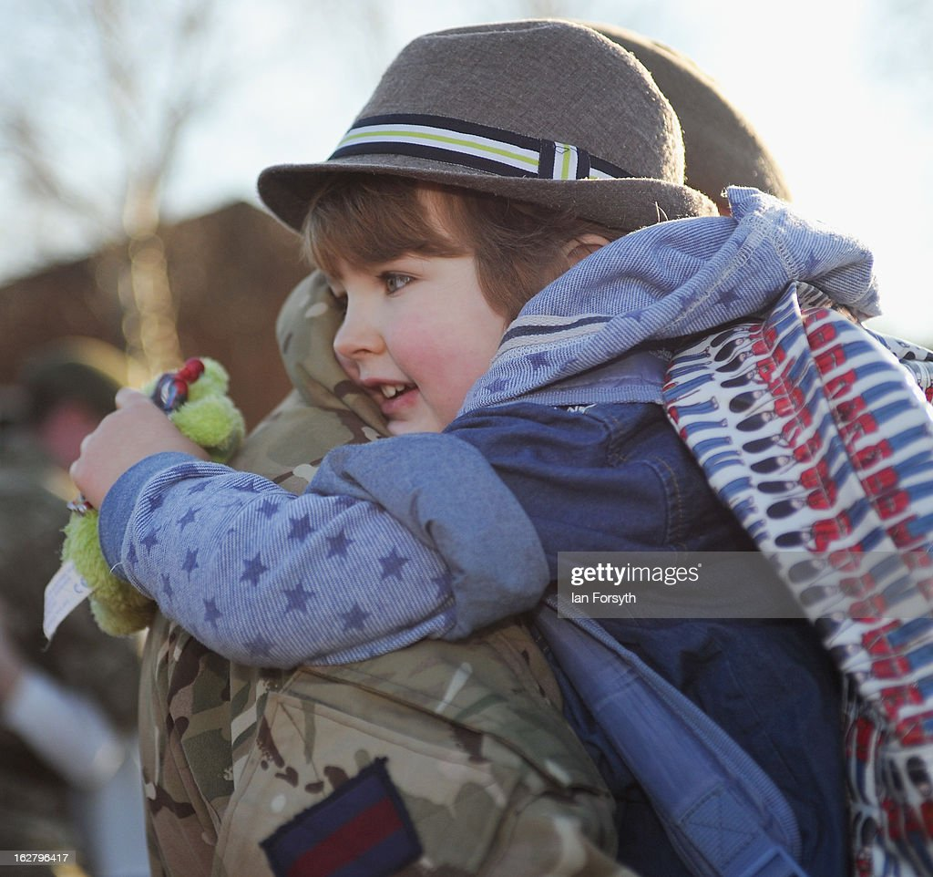 Lance Sergeant Ed Ennis hugs his son Finlay, 4, as soldiers from Headquarters Company 1st Battalion The Scots Guards return to their base at Bourlon Barracks and are reunited with their families following their recent deployment to Afghanistan on February 27, 2013 in Catterick, England. The soldiers are the first troops from 4 Mechanized Brigade to return to their base from their tour of duty in Afghanistan where they were responsible for the training and mentoring of the Afghan national security forces.