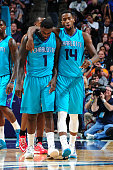 Lance Stephenson and Michael KiddGilchrist of the Charlotte Hornets celebrate during the game against the Milwaukee Bucks on October 29 2014 at Time...