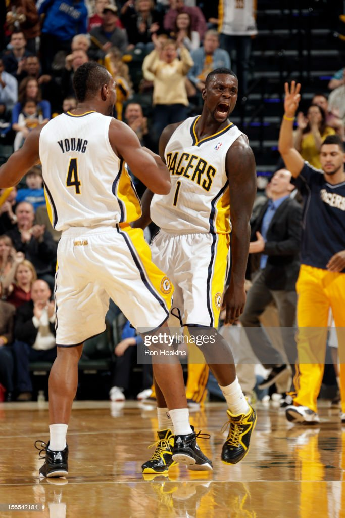 Lance Stephenson #1 and Sam Young #4 of the Indiana Pacers celebrate during the game against the Dallas Mavericks on November 16, 2012 at Bankers Life Fieldhouse in Indianapolis, Indiana.