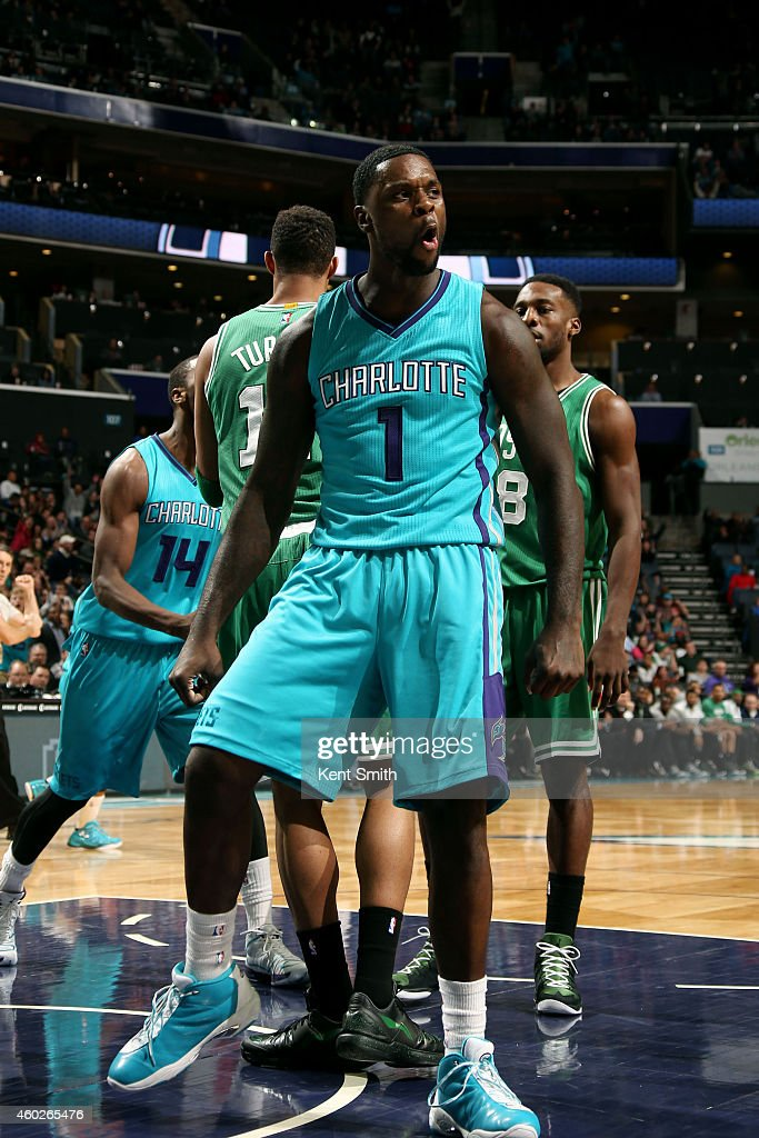 Lance Stephenson of the Charlotte Hornets celebrates during a game against the Boston Celtics during the game at the Time Warner Cable Arena on...