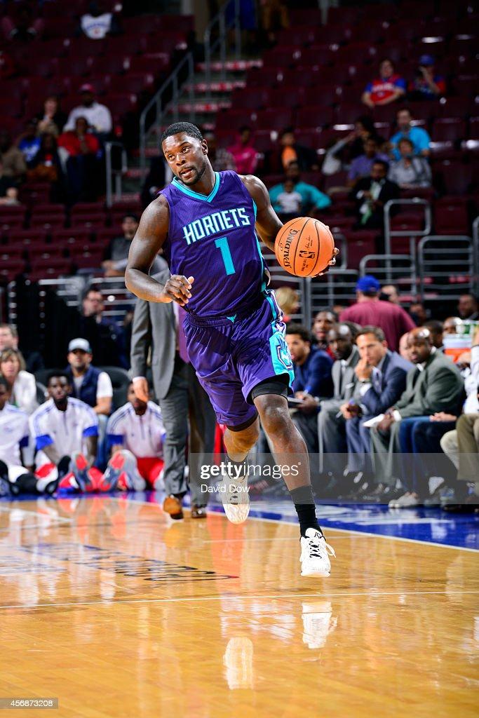 Lance Stephenson of the Charlotte Hornets drives against the Philadelphia 76ers at the Wells Fargo Center on October 08 2014 in Philadelphia...