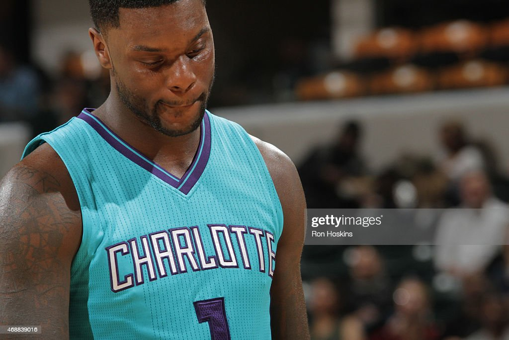 Lance Stephenson of the Charlotte Hornets stands on the court during a game against the Indiana Pacers on April 3 2015 at Bankers Life Fieldhouse in...