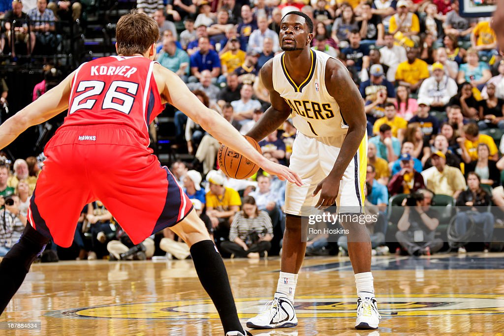 Lance Stephenson #1 of the Indiana Pacers advances the ball against Kyle Korver #26 of the Atlanta Hawks in Game Five of the Eastern Conference Quarterfinals during the 2013 NBA Playoffs on May 1, 2013 at Bankers Life Fieldhouse in Indianapolis, Indiana.