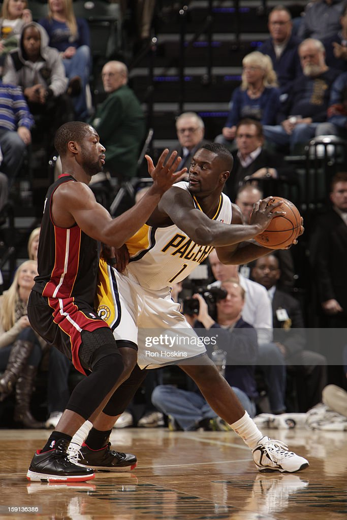 Lance Stephenson #1 of the Indiana Pacers controls the ball against Dwyane Wade #3 of the Miami Heat on January 8, 2013 at Bankers Life Fieldhouse in Indianapolis, Indiana.
