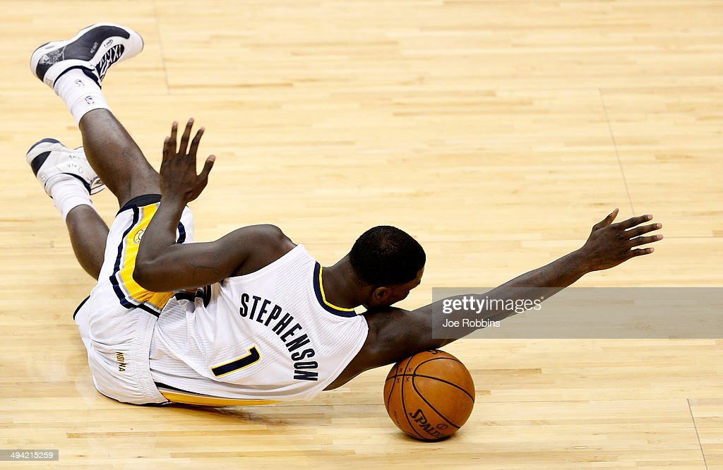 <a gi-track='captionPersonalityLinkClicked' href=/galleries/search?phrase=Lance+Stephenson&family=editorial&specificpeople=5298304 ng-click='$event.stopPropagation()'>Lance Stephenson</a> #1 of the Indiana Pacers dives for a loose ball against the Miami Heat during Game Five of the Eastern Conference Finals of the 2014 NBA Playoffs at Bankers Life Fieldhouse on May 28, 2014 in Indianapolis, Indiana.