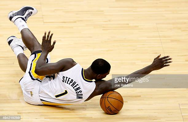 Lance Stephenson of the Indiana Pacers dives for a loose ball against the Miami Heat during Game Five of the Eastern Conference Finals of the 2014...