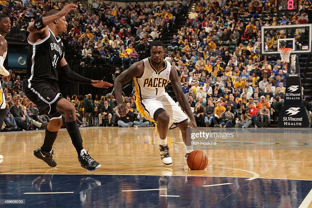 <a gi-track='captionPersonalityLinkClicked' href=/galleries/search?phrase=Lance+Stephenson&family=editorial&specificpeople=5298304 ng-click='$event.stopPropagation()'>Lance Stephenson</a> #1 of the Indiana Pacers dribbles the ball against the Brooklyn Nets at Bankers Life Fieldhouse on December 28, 2013 in Indianapolis, Indiana.