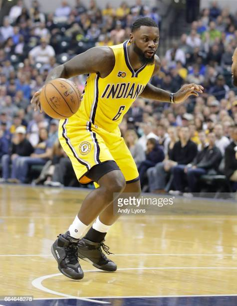 Lance Stephenson of the Indiana Pacers dribbles the ball during the 10890 win over the Toronto Raptors at Bankers Life Fieldhouse on April 4 2017 in...