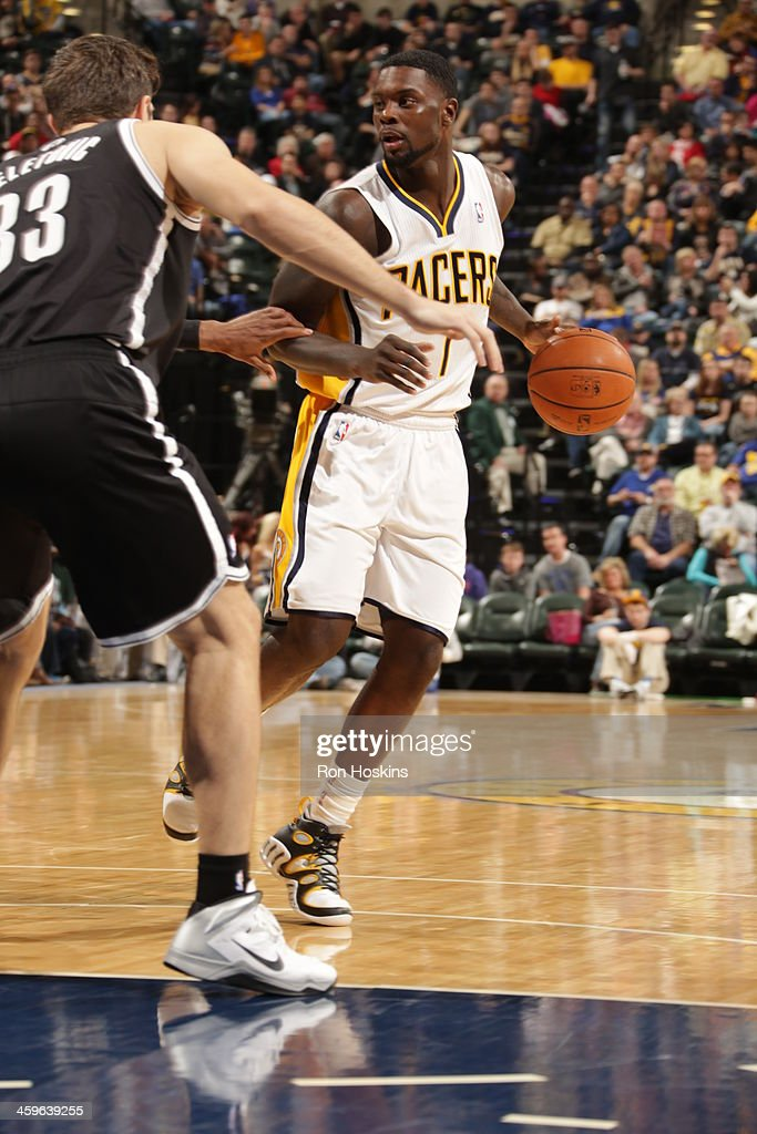 Lance Stephenson #1 of the Indiana Pacers dribbles to the basket against the Brooklyn Nets at Bankers Life Fieldhouse on December 28, 2013 in Indianapolis, Indiana.
