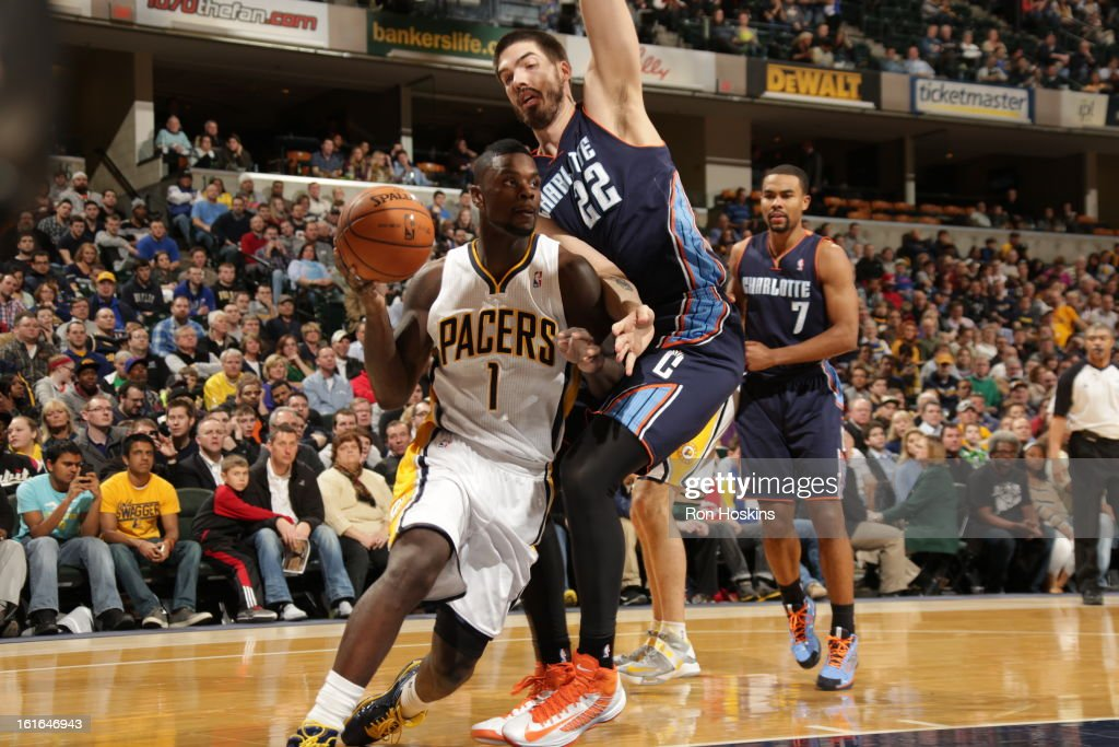Lance Stephenson #1 of the Indiana Pacers drives against Byron Mullens #22 of the Charlotte Bobcats on February 13, 2013 at Bankers Life Fieldhouse in Indianapolis, Indiana.