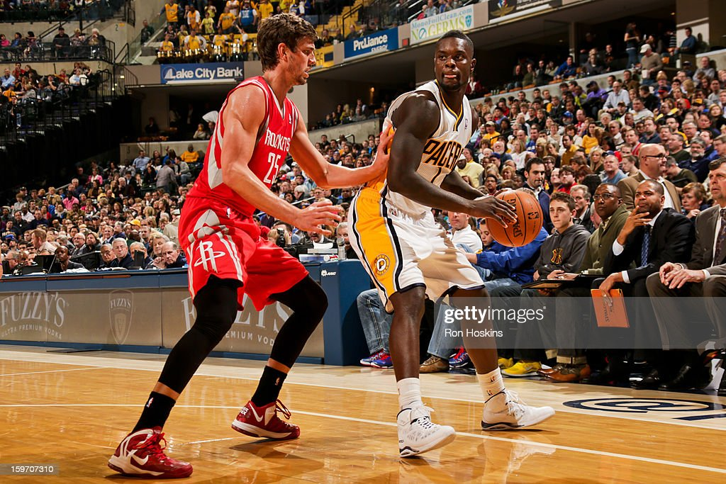 Lance Stephenson #1 of the Indiana Pacers drives against Chandler Parsons #25 of the Houston Rockets on January 18, 2013 at Bankers Life Fieldhouse in Indianapolis, Indiana.