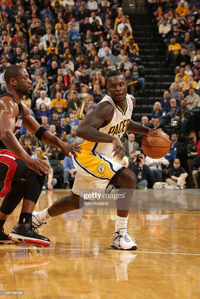 <a gi-track='captionPersonalityLinkClicked' href=/galleries/search?phrase=Lance+Stephenson&family=editorial&specificpeople=5298304 ng-click='$event.stopPropagation()'>Lance Stephenson</a> #1 of the Indiana Pacers drives against <a gi-track='captionPersonalityLinkClicked' href=/galleries/search?phrase=Dwyane+Wade&family=editorial&specificpeople=201481 ng-click='$event.stopPropagation()'>Dwyane Wade</a> #3 of the Miami Heat on January 8, 2013 at Bankers Life Fieldhouse in Indianapolis, Indiana.
