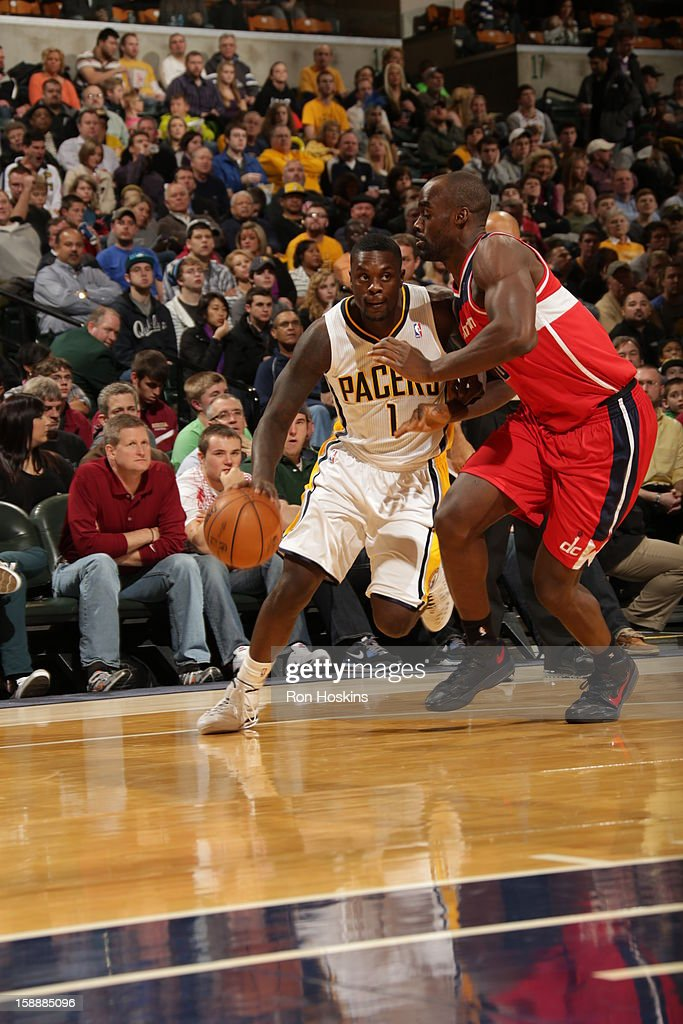 <a gi-track='captionPersonalityLinkClicked' href=/galleries/search?phrase=Lance+Stephenson&family=editorial&specificpeople=5298304 ng-click='$event.stopPropagation()'>Lance Stephenson</a> #1 of the Indiana Pacers drives to the basket against <a gi-track='captionPersonalityLinkClicked' href=/galleries/search?phrase=Emeka+Okafor&family=editorial&specificpeople=201739 ng-click='$event.stopPropagation()'>Emeka Okafor</a> #50 of the Washington Wizards on January 2, 2013 at Bankers Life Fieldhouse in Indianapolis, Indiana.