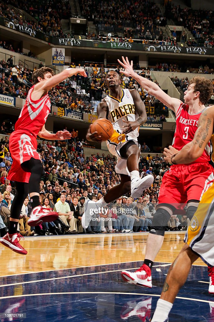 Lance Stephenson #1 of the Indiana Pacers drives to the basket against Omer Asik #3 of the Houston Rockets on January 18, 2013 at Bankers Life Fieldhouse in Indianapolis, Indiana.