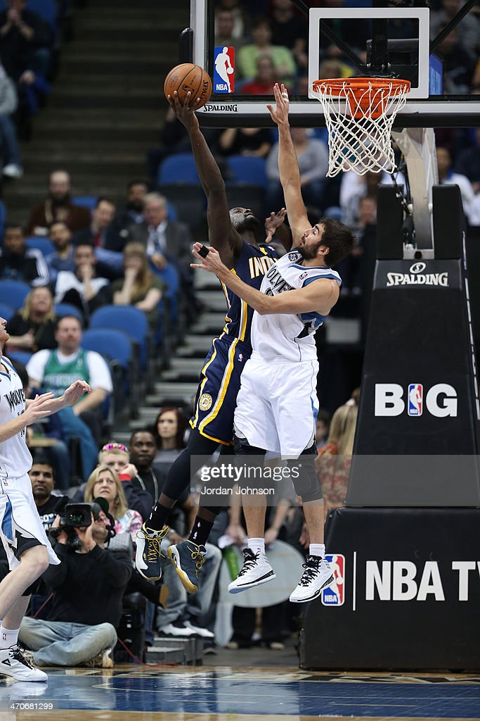 <a gi-track='captionPersonalityLinkClicked' href=/galleries/search?phrase=Lance+Stephenson&family=editorial&specificpeople=5298304 ng-click='$event.stopPropagation()'>Lance Stephenson</a> #1 of the Indiana Pacers drives to the basket and <a gi-track='captionPersonalityLinkClicked' href=/galleries/search?phrase=Ricky+Rubio&family=editorial&specificpeople=4028920 ng-click='$event.stopPropagation()'>Ricky Rubio</a> #9 of the Minnesota Timberwolves tries to block the shot on February 19, 2014 at Target Center in Minneapolis, Minnesota.