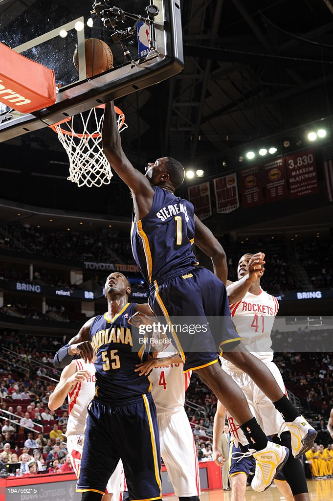 Lance Stephenson #1 of the Indiana Pacers dunks against Thomas Robinson #41 of the Houston Rockets on March 27, 2013 at the Toyota Center in Houston, Texas.