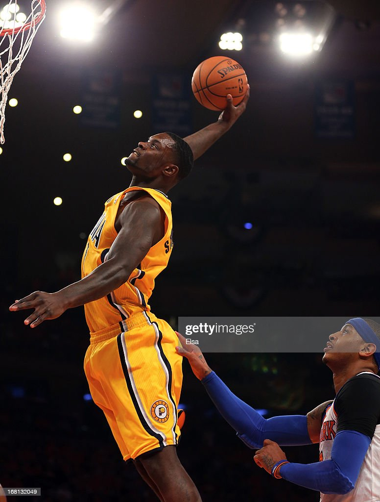 <a gi-track='captionPersonalityLinkClicked' href=/galleries/search?phrase=Lance+Stephenson&family=editorial&specificpeople=5298304 ng-click='$event.stopPropagation()'>Lance Stephenson</a> #1 of the Indiana Pacers dunks the ball as <a gi-track='captionPersonalityLinkClicked' href=/galleries/search?phrase=Carmelo+Anthony&family=editorial&specificpeople=201494 ng-click='$event.stopPropagation()'>Carmelo Anthony</a> #7 of the New York Knicks defends during Game One of the Eastern Conference Semifinals of the 2013 NBA Playoffs on May 5, 2013 at Madison Square Garden in New York City.