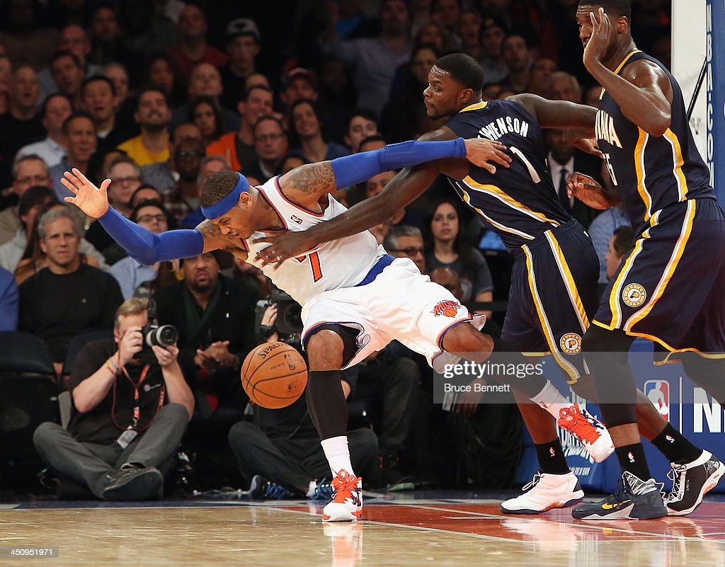 Lance Stephenson #1 of the Indiana Pacers fouls Carmelo Anthony #7 of the New York Knicks in the third quarter at Madison Square Garden on November 20, 2013 in New York City.