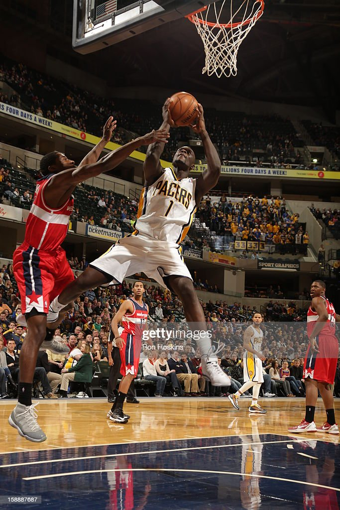 <a gi-track='captionPersonalityLinkClicked' href=/galleries/search?phrase=Lance+Stephenson&family=editorial&specificpeople=5298304 ng-click='$event.stopPropagation()'>Lance Stephenson</a> #1 of the Indiana Pacers goes to the basket against <a gi-track='captionPersonalityLinkClicked' href=/galleries/search?phrase=Jordan+Crawford&family=editorial&specificpeople=4779380 ng-click='$event.stopPropagation()'>Jordan Crawford</a> #15 of the Washington Wizards on January 2, 2013 at Bankers Life Fieldhouse in Indianapolis, Indiana.