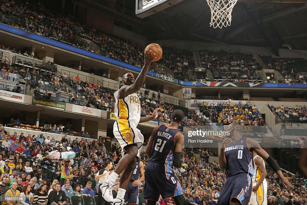 Lance Stephenson #1 of the Indiana Pacers goes to the basket against Hakim Warrick #21 of the Charlotte Bobcats during the game between the Indiana Pacers and the Charlotte Bobcats on January 12, 2013 at Bankers Life Fieldhouse in Indianapolis, Indiana.